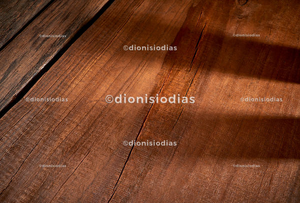 Rustic wooden background with horizontal shadows