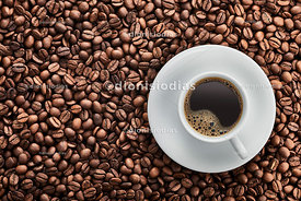 Coffee cup isolated on roasted coffee beans