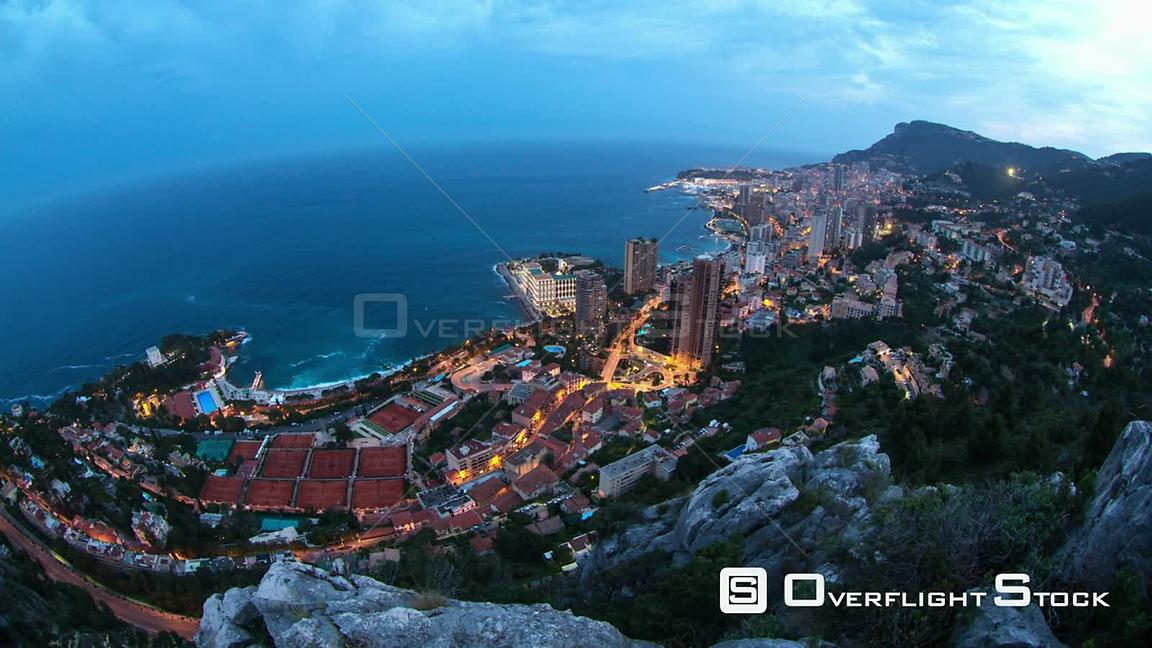 Monaco cityscape time lapse clip from hard to get to cliff using a fisheye lens. Evening to night.