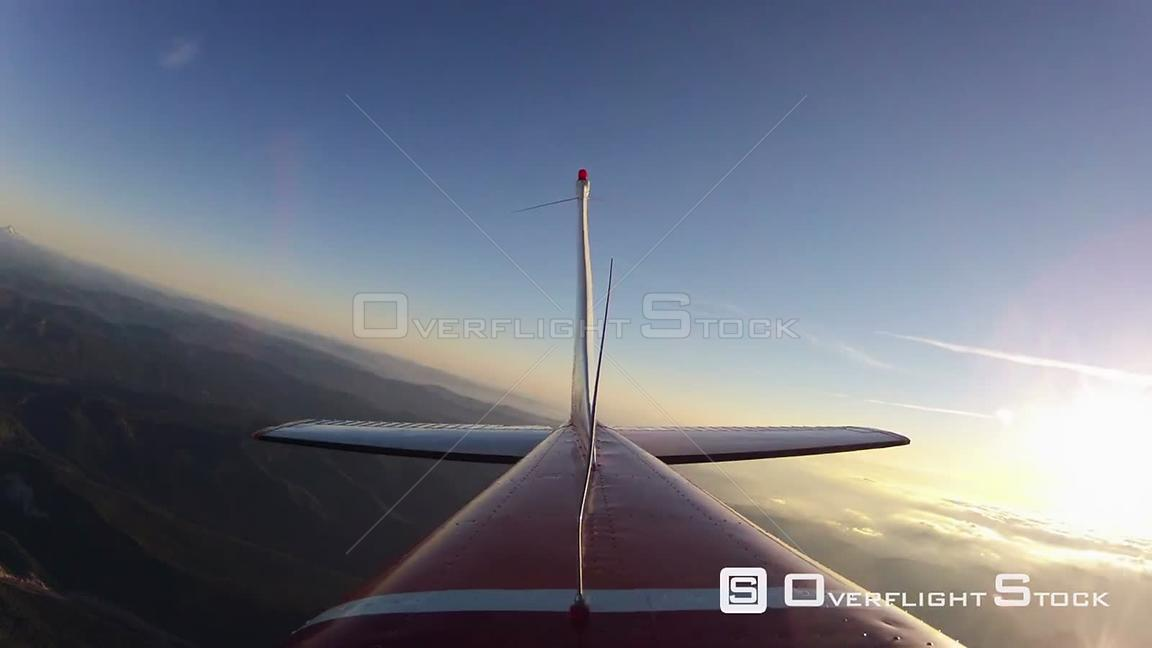 Rear view flying time lapse clip around Mt Hood and into Hood River at sunset. Florida Keys