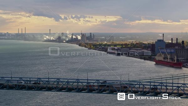 Detroit Michigan Moving from Windsor side to Detroit side following path of bridge with industrial views