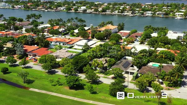 Aerial video Miami Beach luxury homes between golf course and water