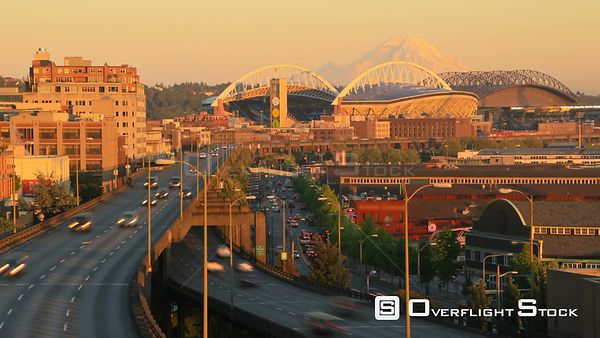 Seattle Washington State USA Seattle city traffic time lapse of waterfront streets and highway 99 with a beautiful sunset and...