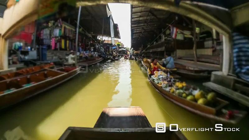 Boat ride time lapse through a floating boat market in Thailand.
