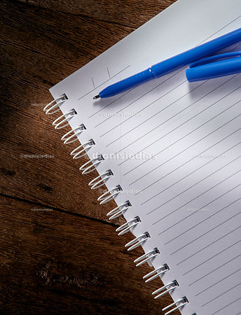 Detail of school notebook on wooden background