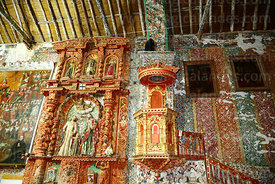 Carved wooden pulpit and side altar with statues of the Holy Family inside the church of the Señor de la Cruz, Carabuco, La P...