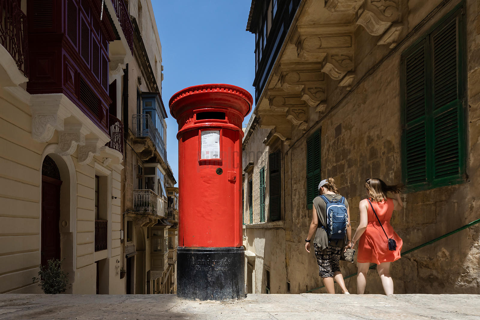 Tourists Walking down MA Vassallis St Past an Old English Postbox