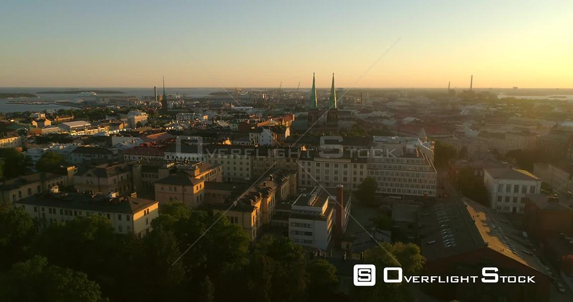 Helsinki cityscape, C4K aerial decreasing tilt view of punavuori and saint john church, in the city of Helsinki, on a sunny s...