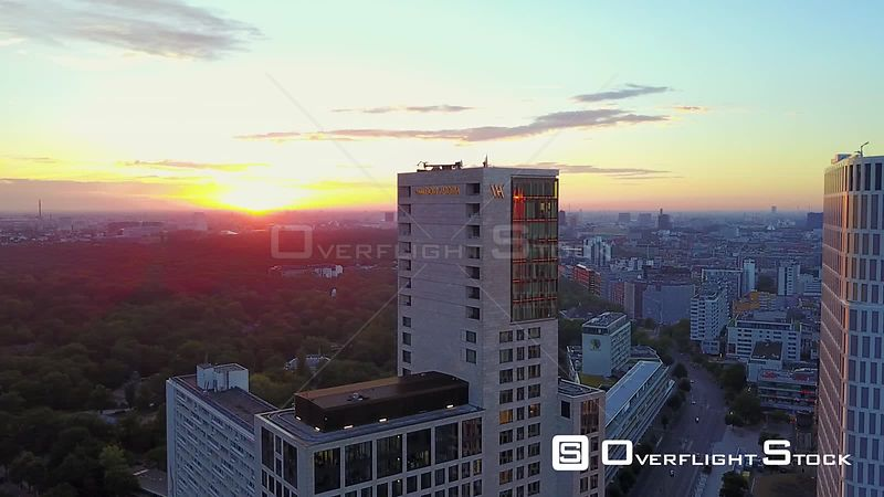 Germany Berlin Aerial Flying low around tall buildings in Charlottenburg area at sunrise