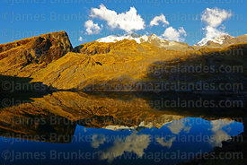 Pico Schulze (a peak on the west side of the Mt Illampu massif) reflected in Laguna Chillata, Bolivia
