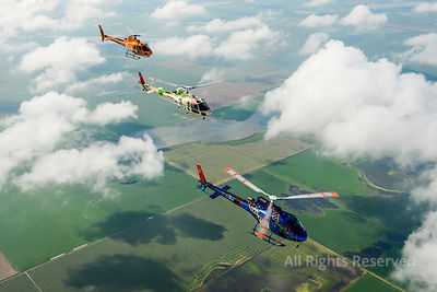 Air to Air Panorama Photo of Three Lined up Colorful Airbus Helicopters As350 B3 Ecureuil (squirrel Astar) Flying Above the C...
