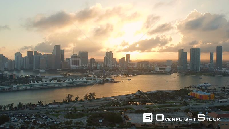 Miami Florida Flying over Watson Island with cityscape views at sunset.
