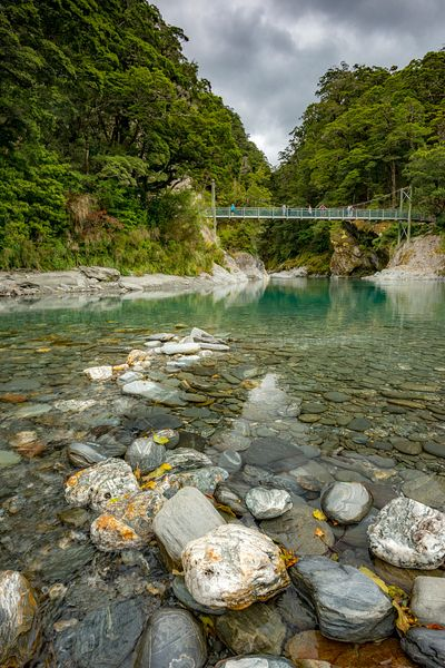 Swing bridge over the Blue Pools in Makarora, New Zealand.