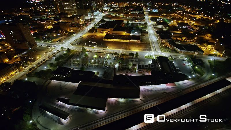 North Carolina Greensboro Aerial Birdseye angle to level panning view of downtown nighttime cityscape