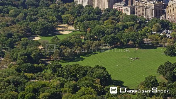 NYC New York Low birdseye Central Park detail view panning to cityscape skyline of Central Park West and Hudson river