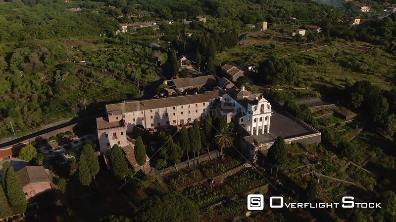 Aerial approaching view of the hermitage of Sant Anna on the slopes of mount Etna in Sicily. Italy