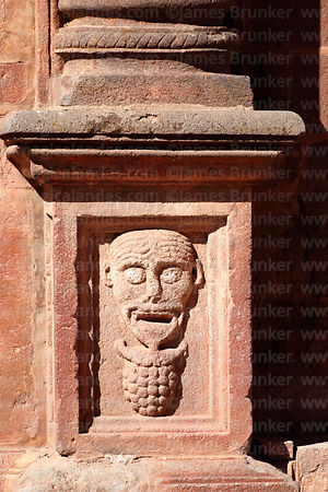 Carved stone face above bunch of grapes on base of main entrance of San Pedro church, Tiwanaku, La Paz Department, Bolivia