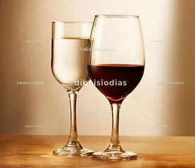 Two glasses of wine, one with red wine and the other with white wine