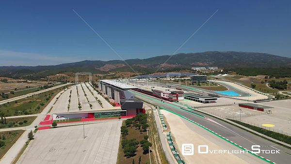 Aerial forward drone shot to pitlane in Algarve International Circuit on a sunny day, in Portimão, Portugal