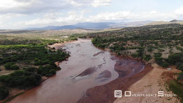 Jeep Crossing a River in Kenya Africa Drone Aerial View