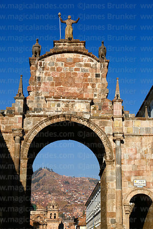 Santa Clara Arch, seen from Plaza San Francisco, San Pedro church in background, Cusco, Peru