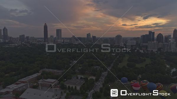Atlanta Panning view of hot air balloons scene at sunset dusk with downtown, midtown, and Buckhead skylines in backdrop