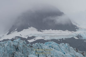 Glacier and hill, Prince William Sound, Alaska, USA