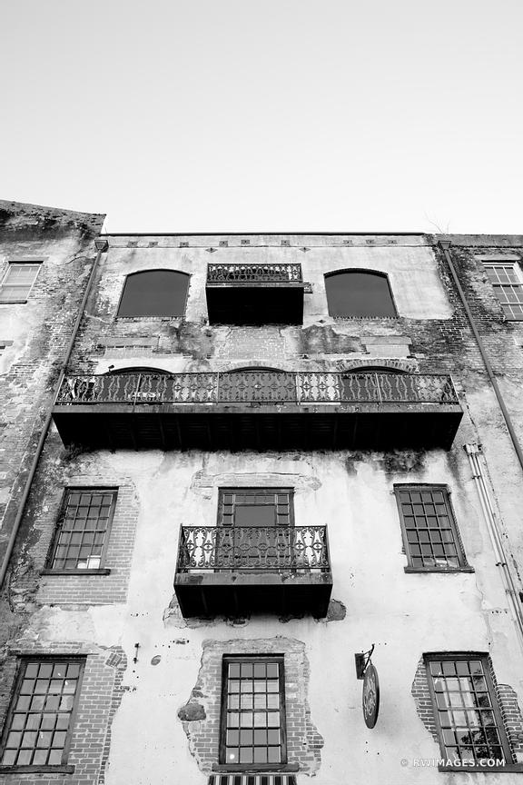 OLD BUILDING FACADE RIVERWALK AREA HISTORIC SAVANNAH GEORGIA BLACK AND WHITE VERTICAL