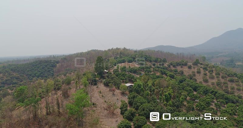 Thung Pi Thailand Aerial Panning close up over house on hill looking down over village