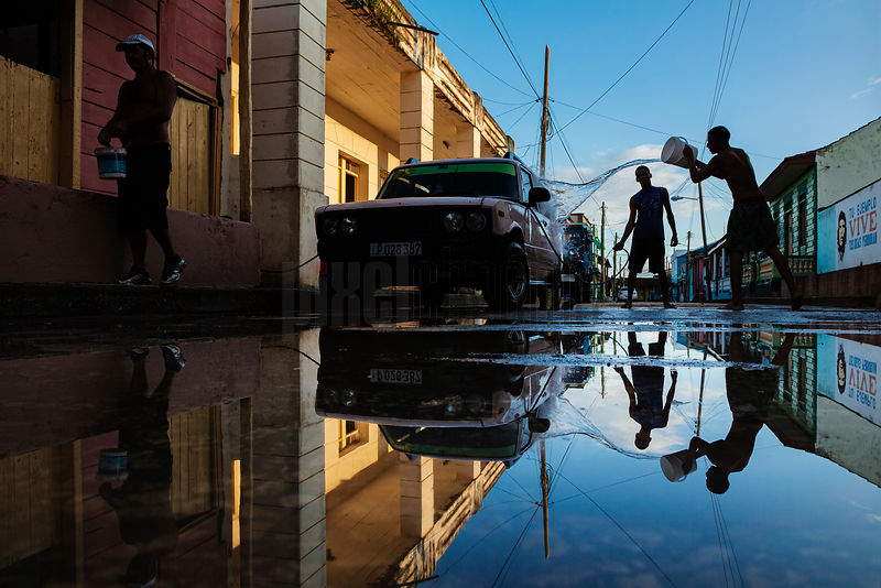 Young Men Washing their Car in Baracoa
