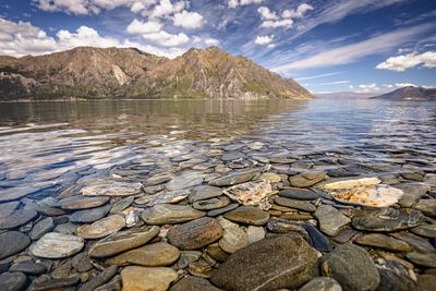 Flat pebbles in the waters of Lake Hawea on New Zealands South Island