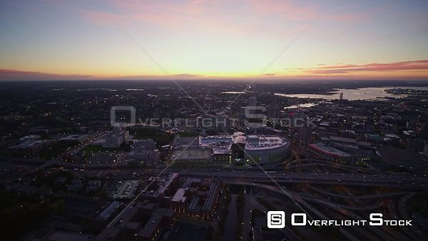 Providence Rhode Island Slight panning sunrise cityscape view with rush hour traffic south to north