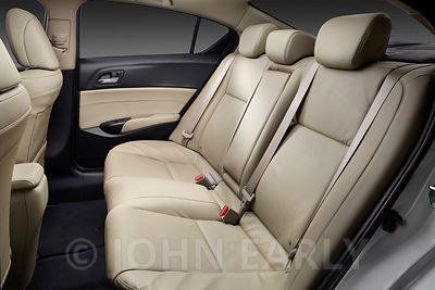 Back Seat View of Luxury Sedan With Tan Leather Seats