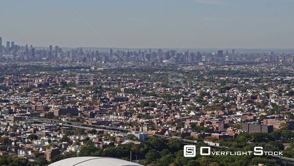 NYC New York High panning cityscape views of Manhattan, Bronx and Queens with baseball stadium in foreground