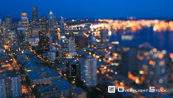 Seattle Washington State USA Seattle cityscape time lapse at dusk using a tilt shift lens with skyscrapers in focus and Ellio...