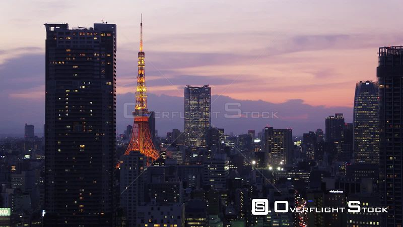 Japan Tokyo Aerial Flying over Shinjuku area cityscape views sunset