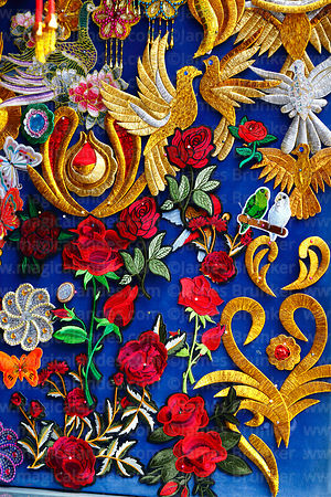 Detail of embroidered items for costumes and festival banners for sale, Cusco, Peru