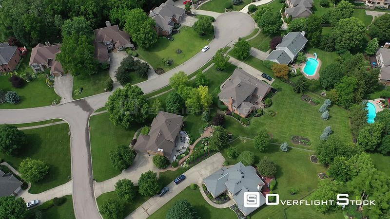 Yards and gardens with large homes in a residential neighborhood, Centerville, Ohio, USA