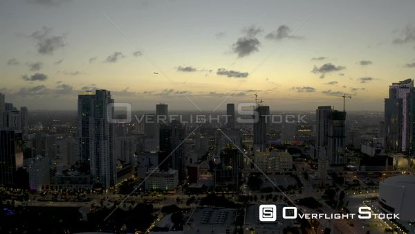 Airplane Flying Over Downtown Miami City Landscape Twilight