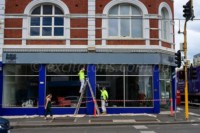 Painter prepare shop for new tennant.