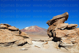 Eroded rock formations in the Siloli Desert and Cerro Cahauana volcano, Eduardo Avaroa Andean Fauna National Reserve, Bolivia
