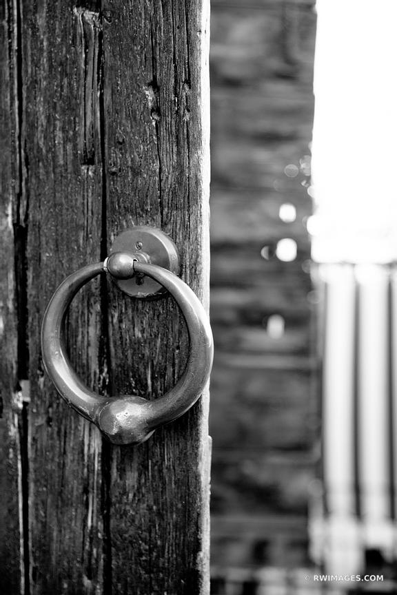 OLD WOODEN DOOR RIVERWALK AREA HISTORIC SAVANNAH GEORGIA BLACK AND WHITE