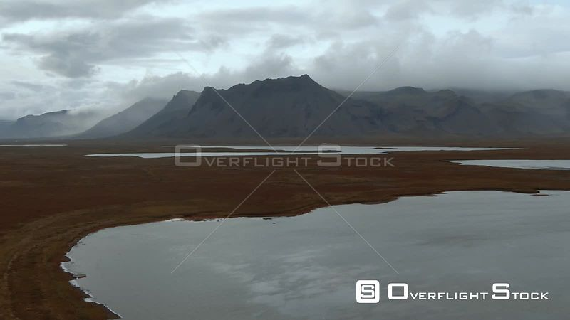 Volcanic Mountains With Clouds in West Iceland