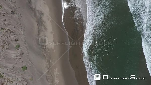 Top Down Drone View of Pacific Ocean Waves on California Beach