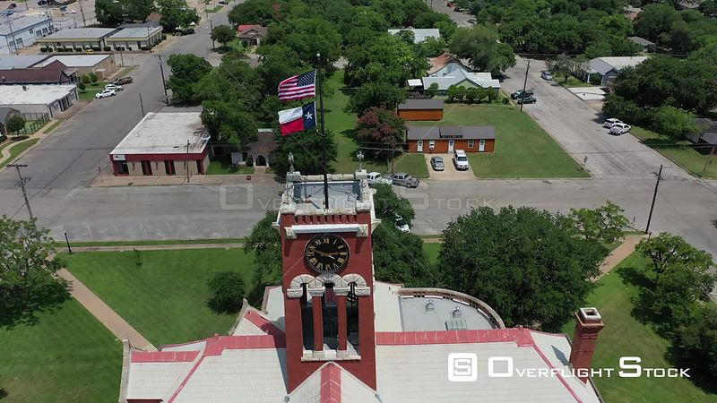 Flags, Clocktower, and Courthouse, Giddings, Texas, USA
