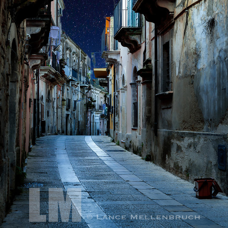 After hours glow falls on a street in Ragusa Ibla