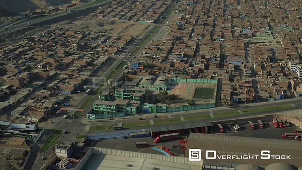 Ventanilla  Peru  Flying low over urban poverty hillside housing area panning up in Mi Peru.