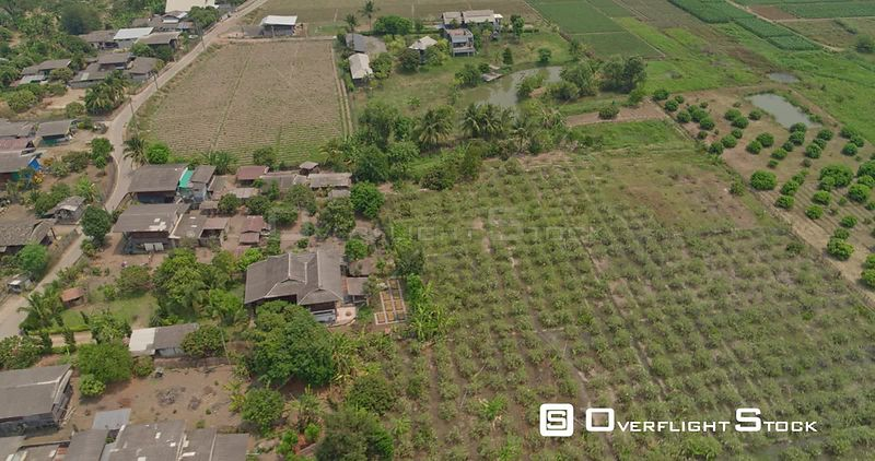 Thung Pi Thailand Aerial Panning birdseye to panoramic view of village and surrounding agriculture crops