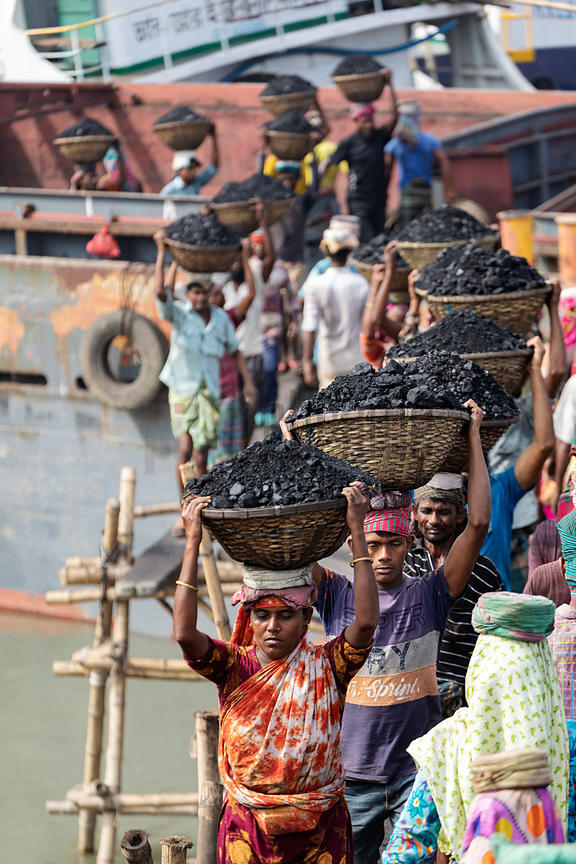 Coal Porters Carry Loads of Coal off a Barge