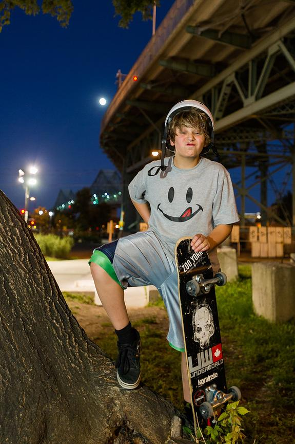 Montreal editorial portrait, Teenager with skateboard under  Jacques Cartier